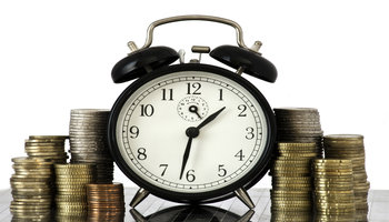 rsz time is money concept alarm clock and lots of euro coins fk5xwird